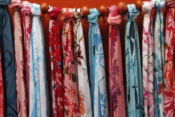 Scarves make attractive and colorful wall decor.