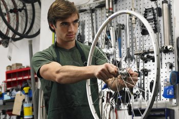 Though not highly paid, many bicycle mechanics love what they do.