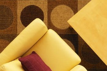 Area rugs draw the eye and define seating areas while covering worn spots on carpet.