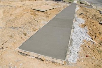 Concrete is poured and stamped before it dries, creating a specific pattern.