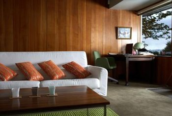 Turn dated paneling into a design statement by decorating in retro-inspired style.