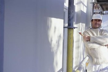 Most painters wash houses with a pressure washer before painting.