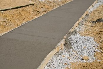A concrete sidewalk typically is strengthened by steel mesh within the poured concrete.
