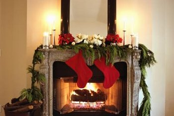 A country mantel decorated for Christmas creates a focal point in the room.