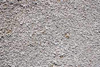 A layer of gravel over dirt will eventually push into the soil to create a surface similar to pavement.