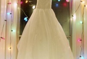 String lights make anything festive, like this display featuring a wedding dress.