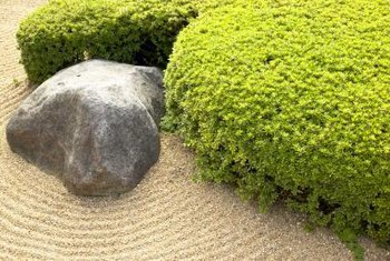 A large boulder forms the center of a Zen garden.