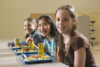 Pediatric dietitians often work with school boards to design healthy lunch menus.