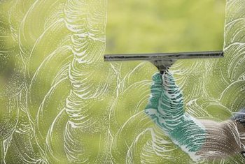 Professionals use a squeegee to wash windows.