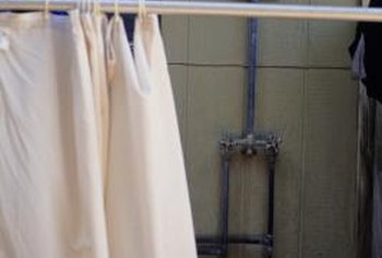 Add length to a recycled shower curtain at the bottom to avoid replacing grommets or ties.