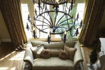 Earthy colors, a wrought-iron chandelier and hardwood floors enhance rustic Italian decor.