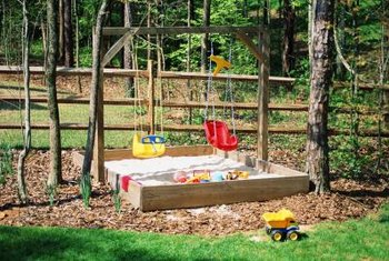 A sandbox can be a simple square or part of an elaborate play center.