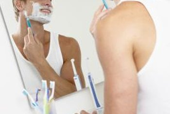 A simple framless mirror works for personal grooming in the bathroom.