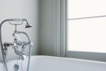 Poorly placed bathroom windows create decorating and privacy challenges.