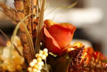 Vibrant and colorful, a dried arrangement is ideal at your fall dinner party.