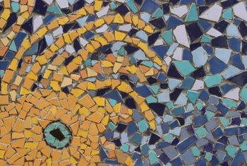 Predetermined mosaic tile patterns often come with mesh backing.