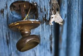 If your door knob is loose, tightening a couple of screws can usually fix it.