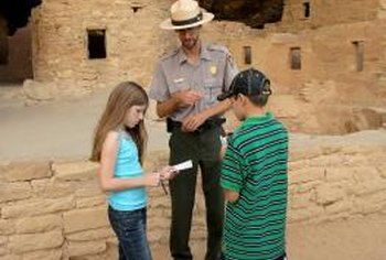Park rangers answer questions and educate visitors about their park's attractions.