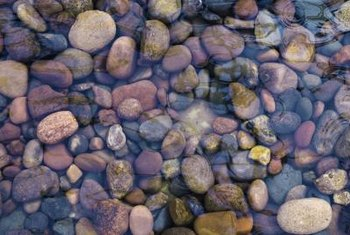 Placing river rocks beneath your fountain gives it a natural quality.