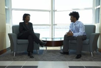 Power words and positive body language make a strong impression in a job interview.