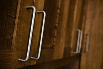 Regular cleaning prevents dirt and tarnish buildup on cupboard handles.