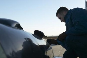 Petroleum supply specialists supervise the fueling of aircraft.