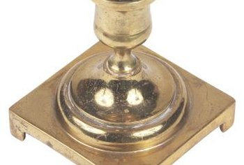 Heat or cold removes hardened wax from brass candlesticks.