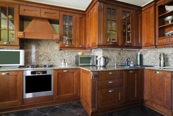 Air out and wash cabinet surfaces to remove odors.