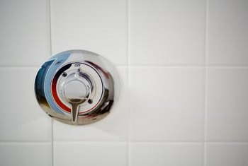 Replace the diverter valve stem if your shower water pressure falls and water starts dripping out the tub faucet.