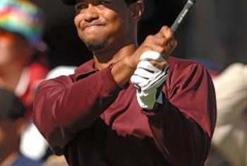 Tiger Woods has used an interlocking grip to win 14 major championships.