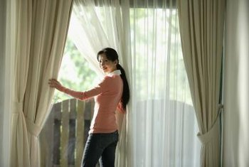 Double curtain rods allow you to easily adjust a room's natural lighting.