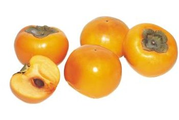 Persimmons are orange-red in color and resemble tomatoes.