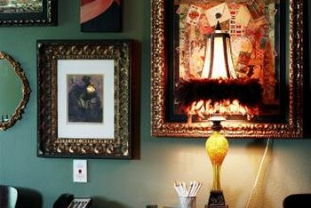 Creating a wall collage from several pieces of artwork can add character to a room.