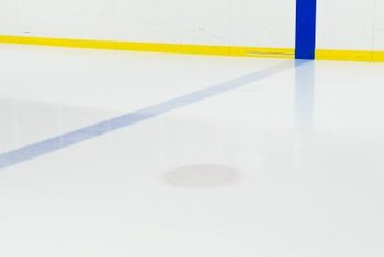 Painting your floor with the regulation red and blue lines can really give your room an authentic hockey rink look.
