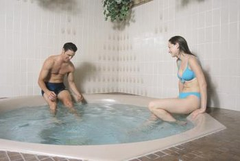 Tile near a hot tub needs frequent cleaning and sealing to avoid damage.