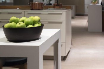 The light tone cabinetry on light tone laminate flooring creates a clean, minimalist space.