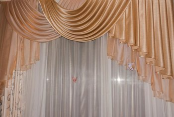 Bustle swags may be combined with cascades or just top plain drapes with an extra flourish.