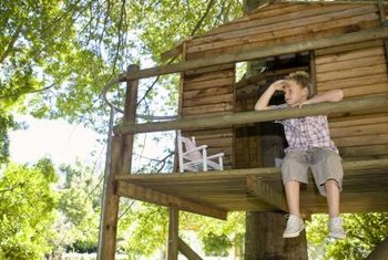 A tree house can be an ideal hangout for children exploring nature.