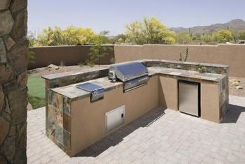 Appliances such as a refrigerator and a warming drawer bring convenience to your grill area.