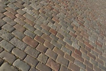 A cobblestone driveway can be an attractive addition to your yard.