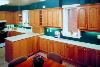 Light oak cabinets don't have to be replaced if you dislike the finish.