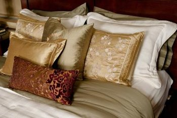 A pleated sham can enliven a bed collection.