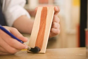 Test stain colors on scrap wood and hold them up to the upholstery to find the ideal shade.