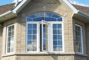 There are several ways to clean your upstairs exterior windows without using a ladder.
