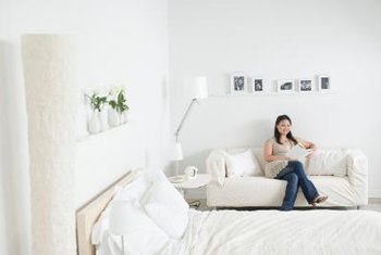 Lamps, plants and pictures brighten dark rooms and bland walls.