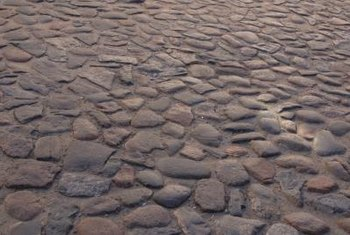 A cobblestone pathway adds old world charm.