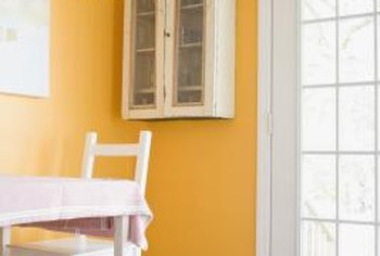 An orange wall can make a strong impression in a home.