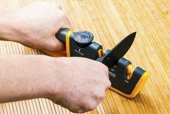 An electric knife sharpener is the easiest method for sharpening a dull blade.