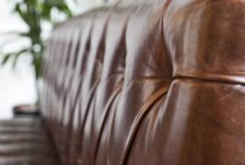 Full-grain leather shows the full, natural texture of the hide.