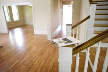 Polished hardwood floors and freshly painted stair banisters refresh tired wood.